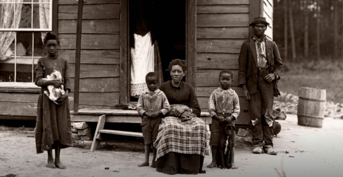 An African-American sharecropping family.